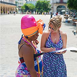 Student interviewing local woman in Havana, Cuba