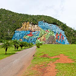 Mural de la Prehostoria, art painted on the side of a cliff within Parqye Nacional Vinales