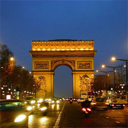 Business students will enjoy a visit to the Arc de Triomphe (shown here at night) on the Champs-Élysées, in Paris a key area to study tourism, hotel management and hospitality.