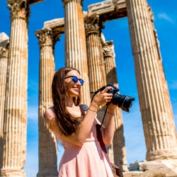 Photography student in Athens, Greece reviews a picture she took on a study tour at Zeus' temple in the Acropolis.