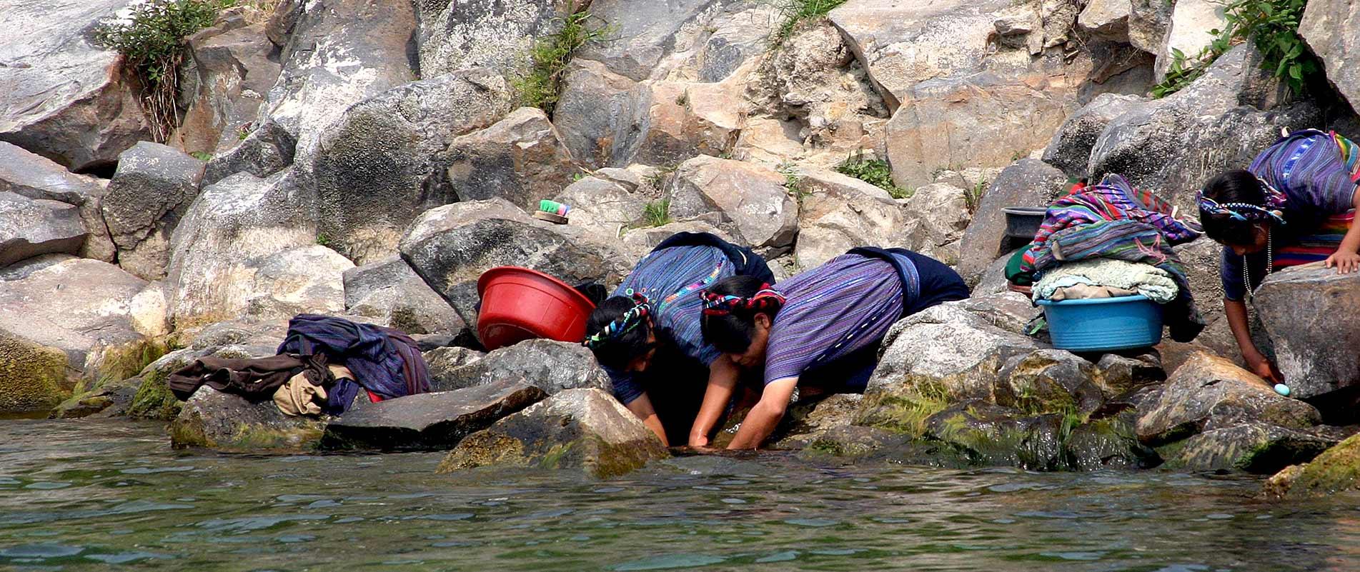 Guatemalan women washing their clothes in Lake Atitlan