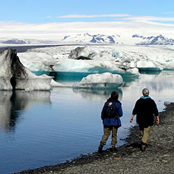 Students walking through Jokulsarlon Vatnajokull National Park in Iceland