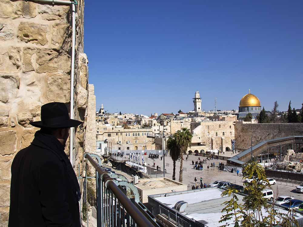 Panoramic view of Jewish man overlooking the Wailing Wall in Jerusalem, Israel.