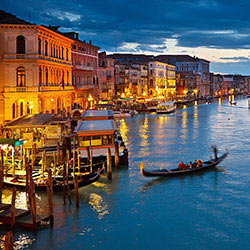 The Grand Canal in Venice, Italy lit up at night.
