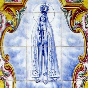 Close up of a painting of the Virgin Mary on a tile in Portugal.