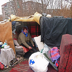 Homeless Romanian woman receiving aid from a local ministry