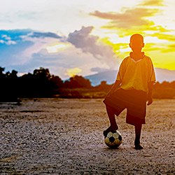 Young boy playing soccer in South Africa