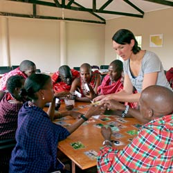 Student volunteering with members of a Maasai tribe in Tanzania as part of a service-learning project.
