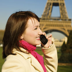 Woman talking on a global cell phone