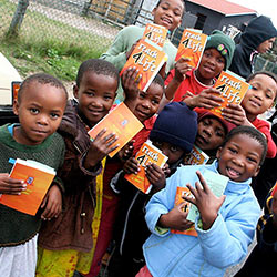 Local School kids in Zimbabwe holding books