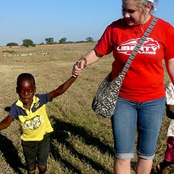 Student playing with a local boy during a mission trip to Zimbabwe